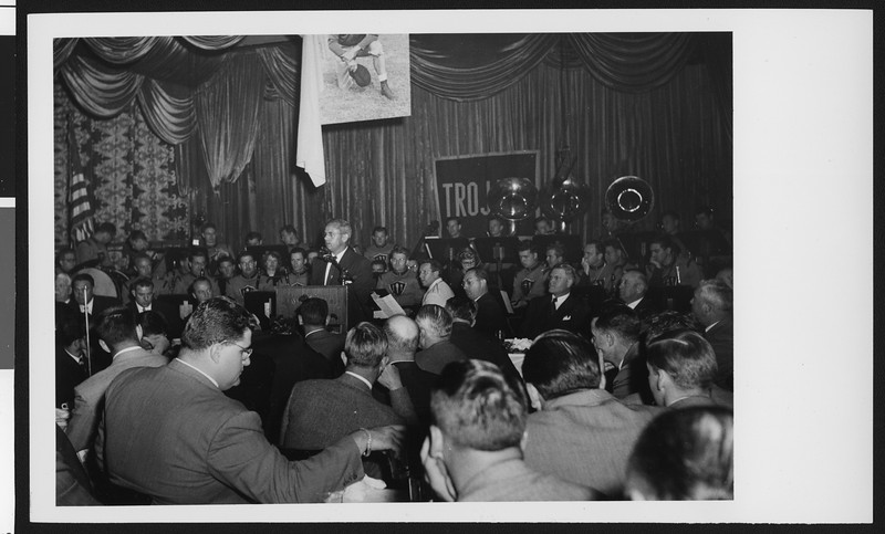 University of Southern California head football coach Jess Hill speaking to a large crowd at a lunch celebrating his appointment to head football coach, Los Angeles, 1951.