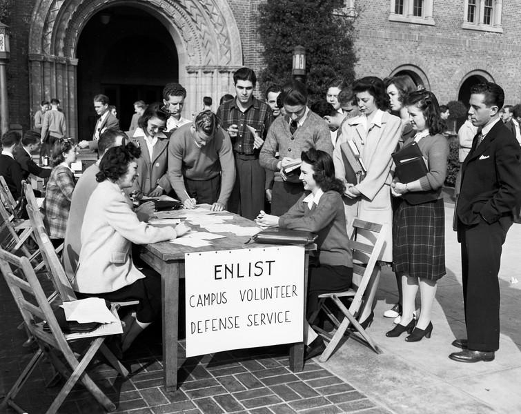 Students, both men and women, waiting in line to sign up for the Campus Volunteer Defense Service, USC, 1941
