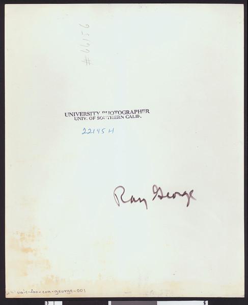 University of Southern California assistant football coach Ray George, studio shot, diagonally striped tie, grey jacket, 1949.