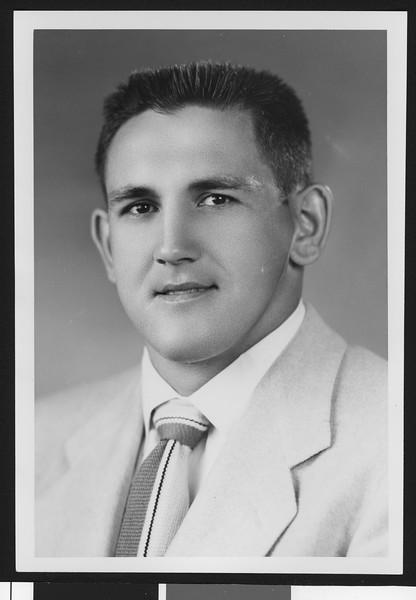 University of Southern California football line coach Don Clark, studio shot in light jacket, 1951.