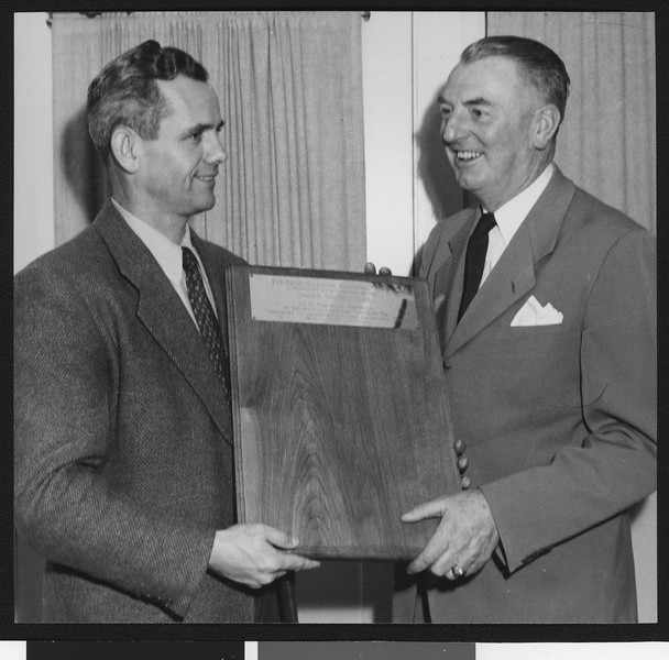 Jess Hill and University of Southern California sports coach Sam Barry (right) holding the new Ernie Holbook Award in 1947, USC campus.
