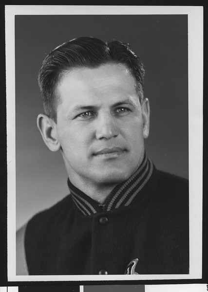 University of Southern California assistant football coach Joseph Muha, studio shot in letter jacket, 1951.