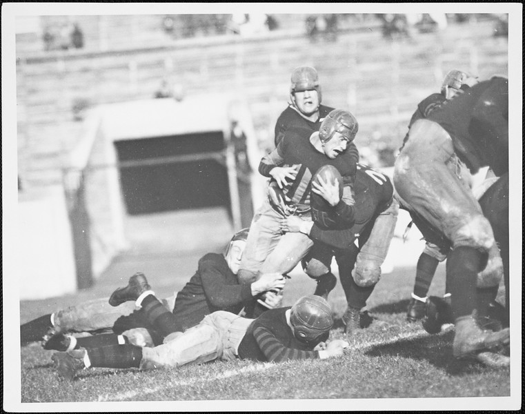 Football players at a USC game, [s.d.]