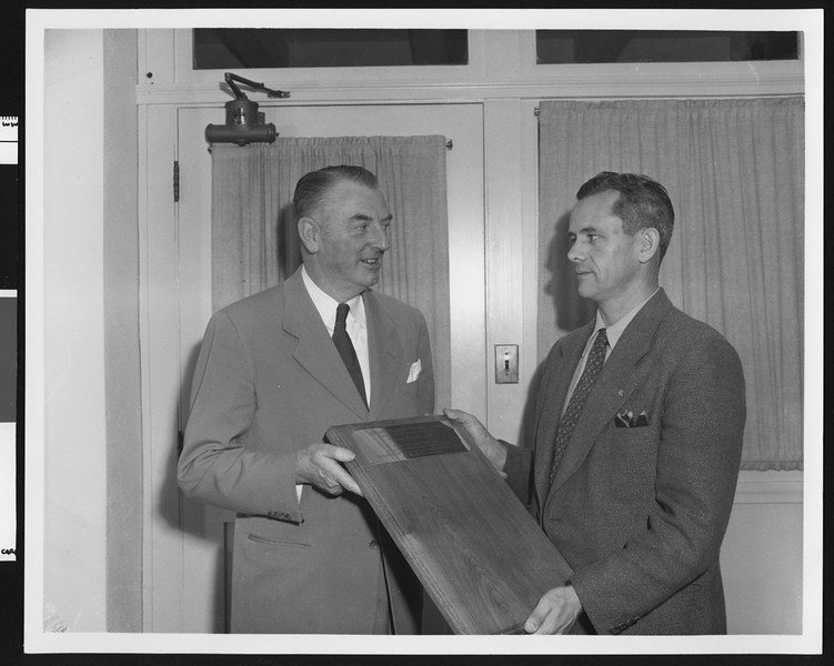 University of Southern California sports coach Sam Barry (left) and Jess Hill holding the new Ernie Holbook Award in 1947, USC campus.