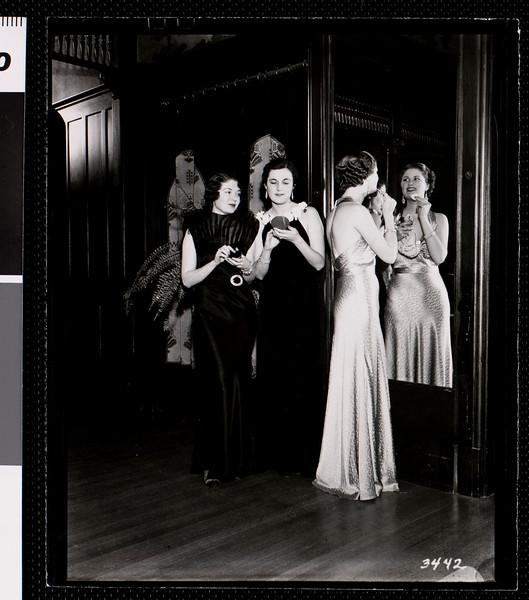 USC Delta Delta Delta sorority women primping in front of a huge wall mirror, ca.1921-1945