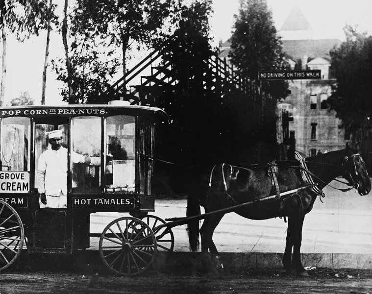 Tom, the Hot Tamales Man, and his horse drawn refreshment wagon, USC, 1910