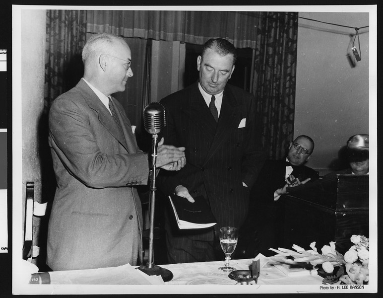 University of Southern California assistant football coaches Sam Barry being presented with a book at a banquet, 1940s, unknown location.