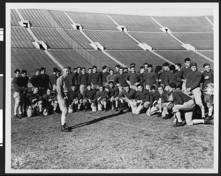 University of Southern California football coach Howard Jones, opening day of football practice 1938, speaking to entire football team in LA Coliseum.