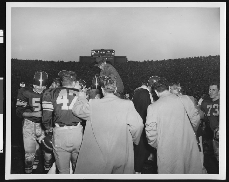 University of Southern California football team celebrates 1953 Rose Bowl win by hoisting head coach Jess Hill on their shoulders, Rose Bowl, 1953.