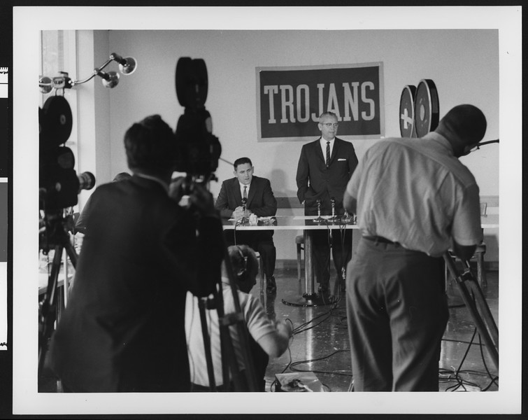 University of Southern California athletic director Jess Hill (right) speaking at a press conference for Don Clark's resignation as football coach, USC campus, 1959.