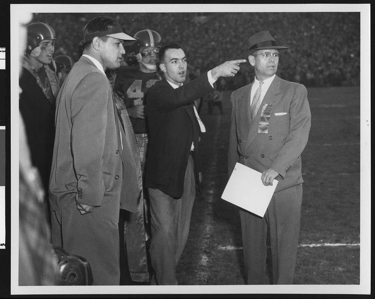 University of Southern California football coaches Hill, Broadbent, and Muha coaching the Rose Bowl game, USC vs. Wisconsin, 1953.