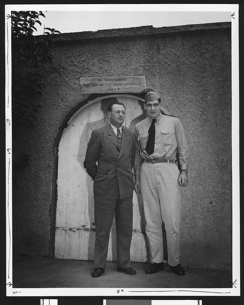 University of Southern California football coach Jeff Cravath with USC football player John Ferraro in front of Bovard Field Gate, USC campus, 1944.