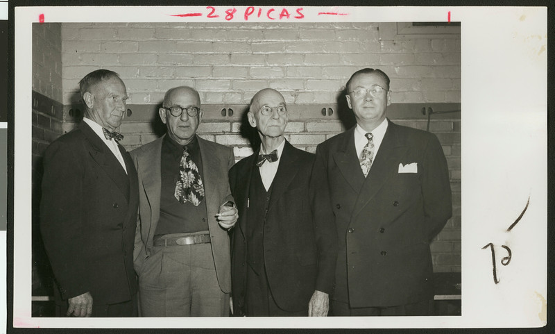 Four coaches for University of Southern California football, years 1888 through 1950, at a football banquet, Los Angeles, 1950.