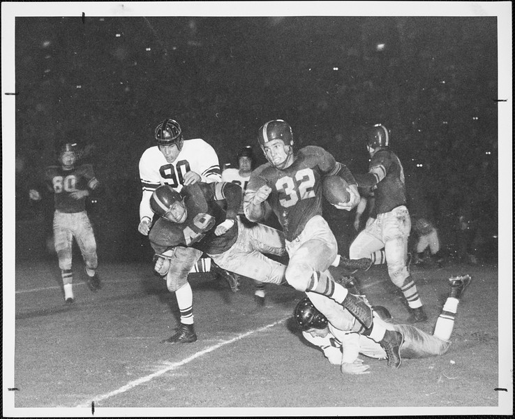 USC player Jim Sears running with the football in the game against Northwestern, 1952