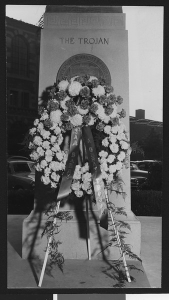 The funeral wreath of University of Southern California assistant football coach Sam Barry, at the base of the Trojan Shrine, USC campus, 1950.