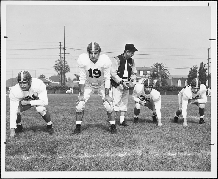 USC football coach Jess Hill with players Al Carmichael, Dean Schneider, Pat Duff and Frank Gifford, 1951
