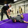 KRISTOPHER RADDER — BRATTLEBORO REFORMER<br /> Deputy First Class Christopher Devito demonstrates how to put a person in handcuffs that is laying down during a  use of force training at the multipurpose room inside Brattleboro Union High School on March 2, 2020.
