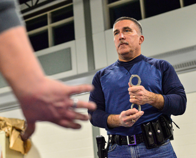 KRISTOPHER RADDER — BRATTLEBORO REFORMER<br /> Deputy First Class Michael Roj, of the Windham County Sheriff's office, approaches from a 45-degree angle to place the handcuffs on during a  use of force training at the multipurpose room inside Brattleboro Union High School on March 2, 2020.