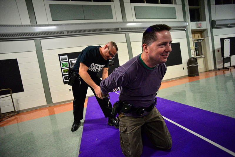 KRISTOPHER RADDER — BRATTLEBORO REFORMER<br /> At the multipurpose room at Brattleboro Union High School, members of the Windham County Sheriff's Department get a refresher on the use of force training on Monday, March 2, 2020.
