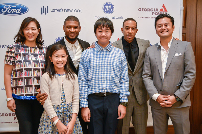 Michele Lai and family with Usher and Ludacris