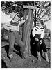 Postcard of Harry & Margaret beneath the Jesse James sign