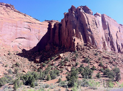 Vertical walls, fairly wide canyon