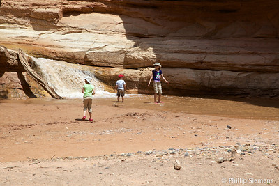 Kids, water, rocks, sticks. What more could one want?
