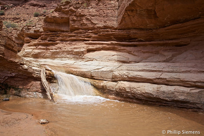1/10 second exposure hand held. Love image stabilization. Sulfur Creek in Capitol Reef