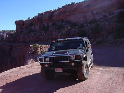Hummer parked along the White Rim Trail Road