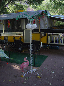No decent camp site is complete without a palm tree and flamingo.
