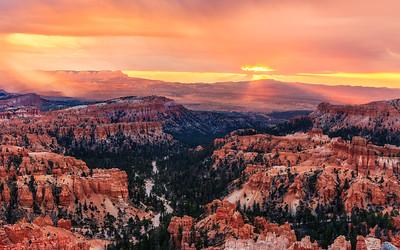 Rain falling across Bryce Canyon at sunrise