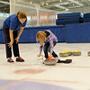 Coach and Girl in Learn to Curl Lesson