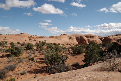 Including views of the areas that look interesting, but where the trail does not go.  Hmmm. Maybe have to check that out some time.  A small arch (NOT Delicate Arch : ) can be seen in the far distance to the right in the photo below.