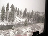 Snow falls on the Truckee River
