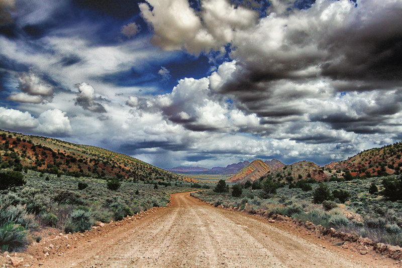 Day 4. Afternoon decision to walk a trail to some slot canyons. Trail head off 8 mile dirt road. Ominous clouds? We thought not.