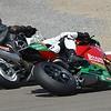 Modern Ducati passing vintage Suzuki GSXR