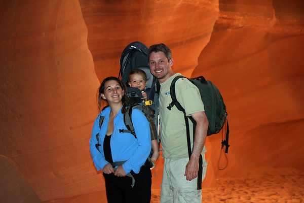 At the entrance of Upper Antelope Canyon. The walls were glowing an amazing orange from the afternoon sun that filtered in from above. Alex was all smiles and really enjoyed his time in backpack pulling Mom's hair.