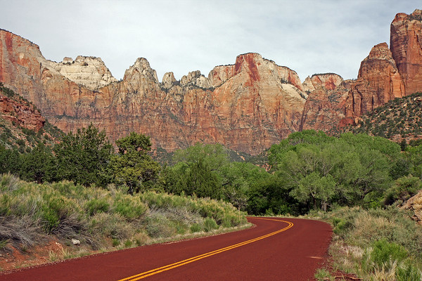 A road bending through Zion National Park.