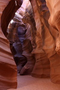 Just inside the entrance of Upper Antelope Canyon outside of Page, Arizona. The walls have been shaped over thousands of years by flood waters. Eventually these waters dump into the Colorado River, and what is now Lake Powell just a few miles away.