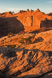 Delicate Arch, sunrise Large scale dune crossbedding Entrada Sandstone, Jurassic Arches National Park, Utah