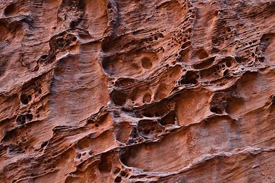 Canyon wall dissolution pockets