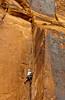 Rock wall climbing along the Colorado River in Utah, USA, America.
