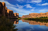 Views of canyon wall and the Colorado river with reflections.
