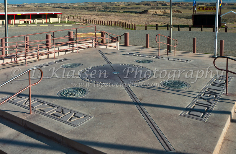 The four corners monument where the states of Airzona, Colorado, Utah and New Mexico have a common geographic corner.