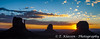 A sunrise view of Monument Valley, its buttes, clouds and spires in the four corners region of Utah, USA.