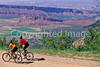 Utah - Mountain bikers above Fisher Towers near Castle Valley - 13 - 72 ppi