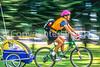 Mother with child in bike trailer - Liberty Park, Salt Lake City, Utah - 12-2 - 72 ppi