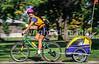 Mother with child in bike trailer - Liberty Park, Salt Lake City, Utah - 13 - 72 ppi