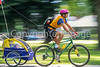 Mother with child in bike trailer - Liberty Park, Salt Lake City, Utah - 10-2 - 72 ppi