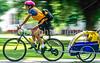 Mother with child in bike trailer - Liberty Park, Salt Lake City, Utah - 17-2 - 72 ppi